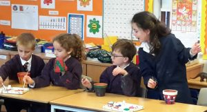 Children hard at work with their plant pots