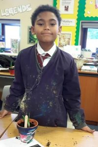 One of the school children with their newest plant creation