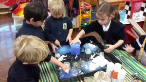 Children creating fake snow