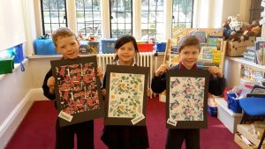 School children showing off their arty creations