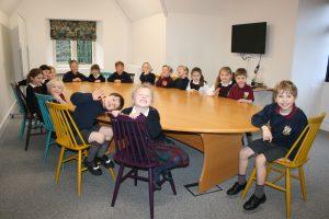 School children sat around the table ready for their studies